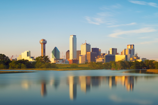 Skyline of Dallas, Texas at sunset seen from over large body of water
