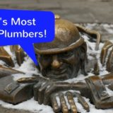 "Bronze statue of a plumber. ""History's most famous plumbers!"""