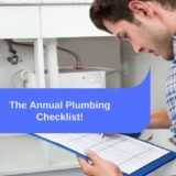 "Plumber in flannel shirt checking items off a list near p-pipe. ""The annual plumbing checklist"""