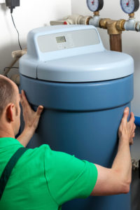Water softener being installed in a boiler room