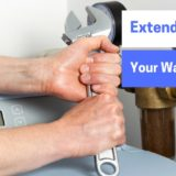 "man holding wrench, preparing to work on water softener. ""Extend the life of your water softener"""