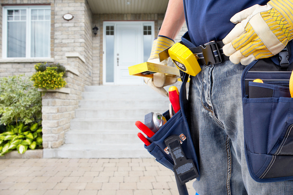 Plumber wearing utility belt preparing for job