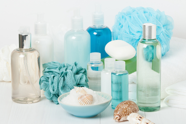 shower supplies including soap shampoo conditioner and sponges