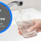 """Person at sink filling up glass with tap water from sink's faucet. """"Is your tap water really safe to drink?"""""""