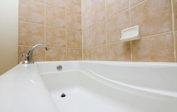 Clean bathtub with tiled wall. How do I clean my bathtub?