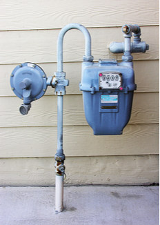 An old, rusty home gas meter.