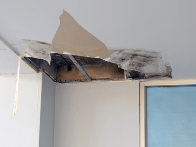 A damaged ceiling from leaking pipe.