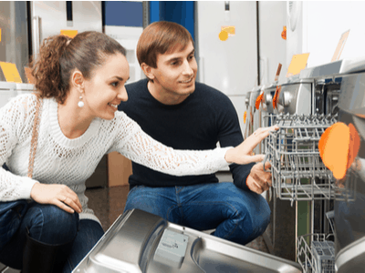 A young couple shops for a new dishwasher.