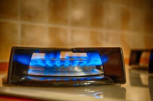 gas top stove burning in kitchen