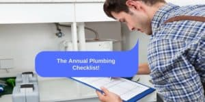 """Plumber in flannel shirt checking items off a list near p-pipe. """"The annual plumbing checklist"""""""