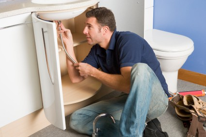 Plumber conducting plumbing maintenance