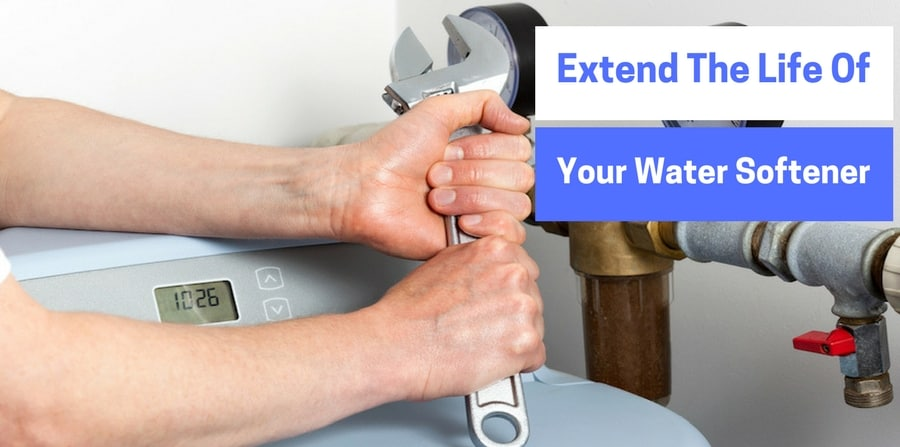 """man holding wrench, preparing to work on water softener. """"Extend the life of your water softener"""""""