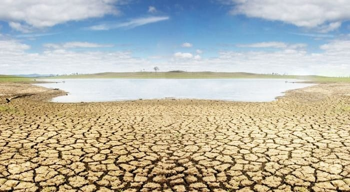 Water sits distantly in a drought.