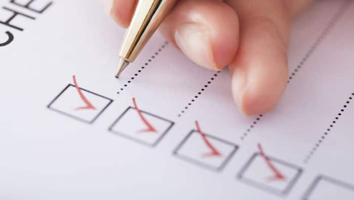 A pen crosses off items on a checklist.