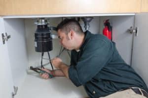 plumber fixing leaking disposal