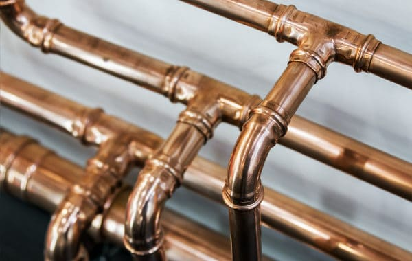 Copper pipes connected by three-way joints - How Does Water Move Through Your House?